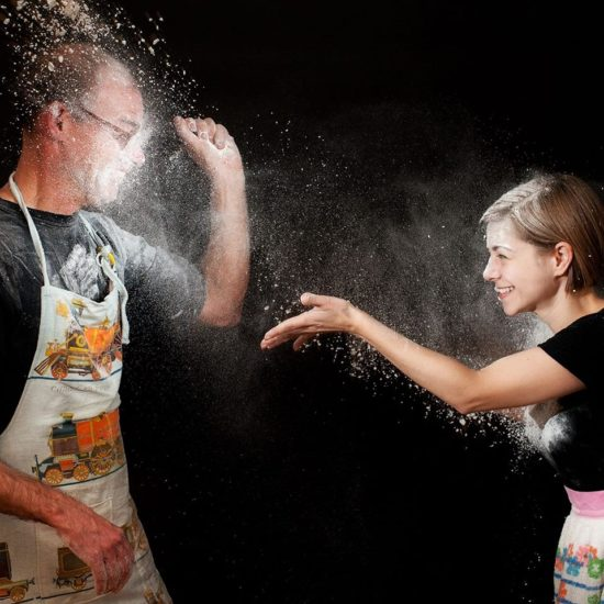 actors playing with flour